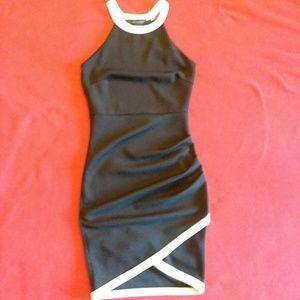 The vintage shop Body enhancing black dress